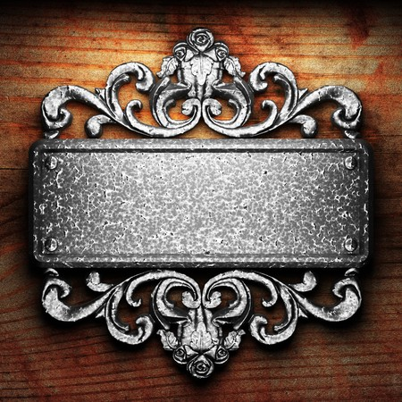 iron ornament on wood made in 3D Stock Photo - 7774668