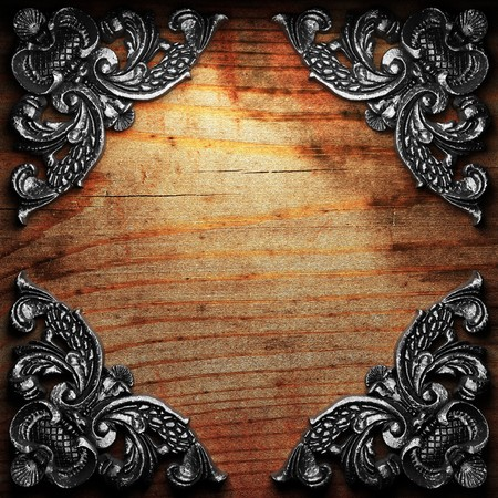 or rust: iron ornament on wood made in 3D Stock Photo