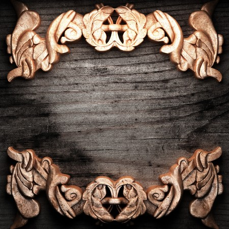 golden ornament on wood made in 3D Stock Photo - 7774669