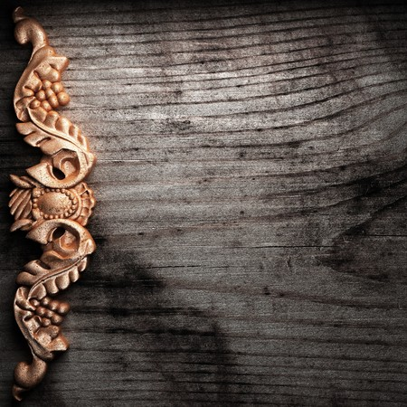 golden ornament on wood made in 3D photo