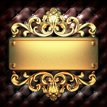 a signboard: golden ornament on leather made in 3D