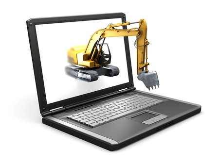 isolated laptop and the Construction vehicle made in 3D 写真素材
