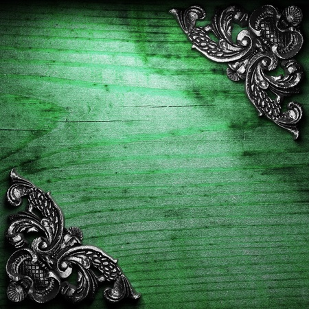 iron ornament on wood made in 3D photo