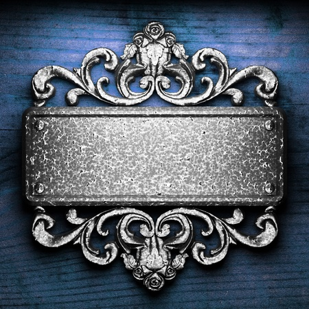 iron ornament on wood made in 3D Stock Photo - 9248208