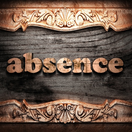 absence: Golden word on wood  Stock Photo