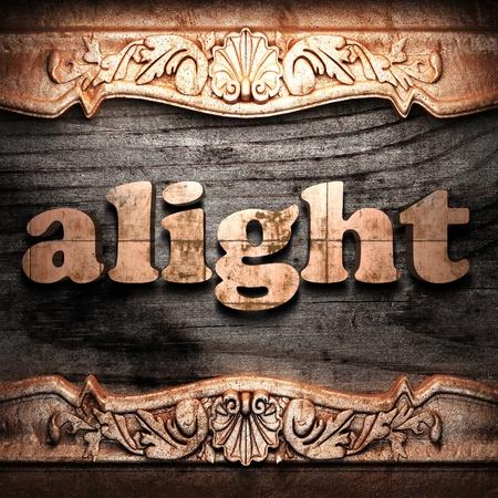 alight: alight on wood carving Archivio Fotografico