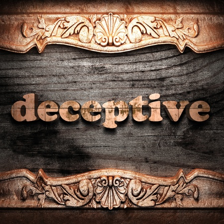 deceptive: Golden word on wood