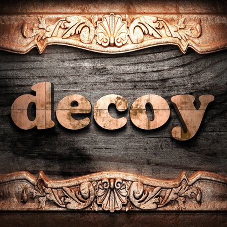 decoy: Golden word on wood
