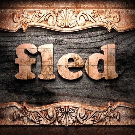 fled: Golden word on wood