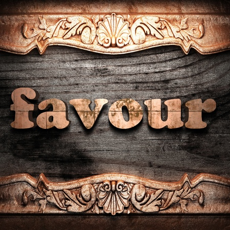 favour: Golden word on wood