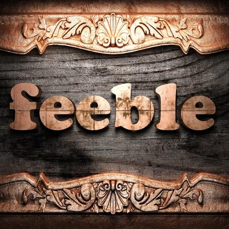 feeble: Golden word on wood
