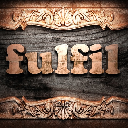fulfil: Golden word on wood