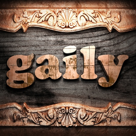 gaily: Golden word on wood