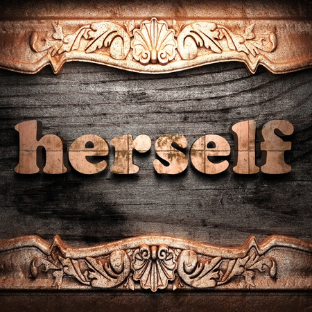 herself: Golden word on wood