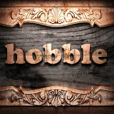 hobble: Golden word on wood