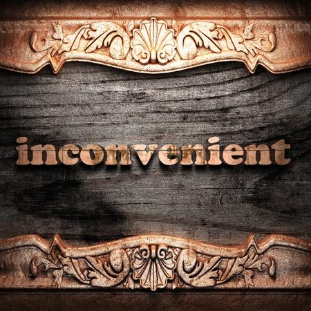 inconvenient: Golden word on wood