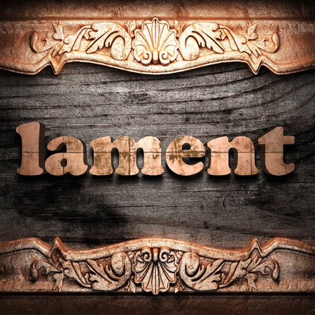 lament: Golden word on wood