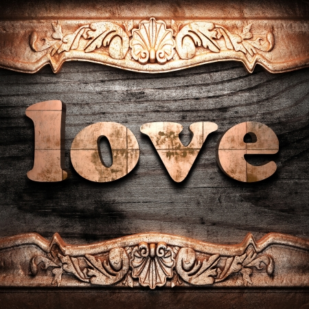 love gold: Golden word on wood