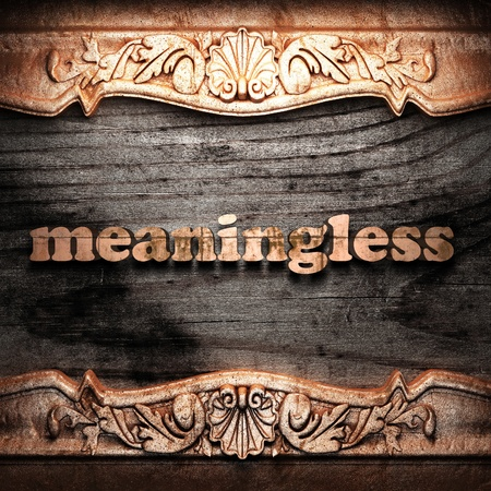meaningless: Golden word on wood