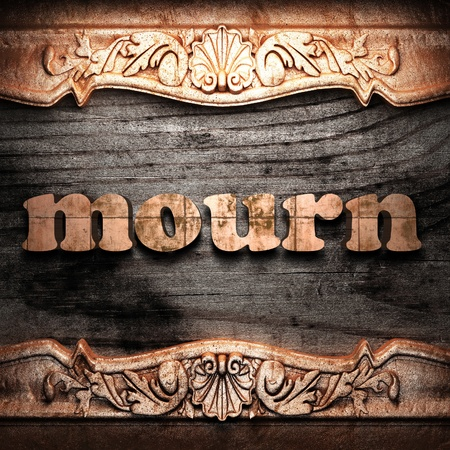 mourn: Golden word on wood