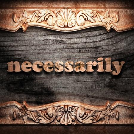 necessarily: Golden word on wood