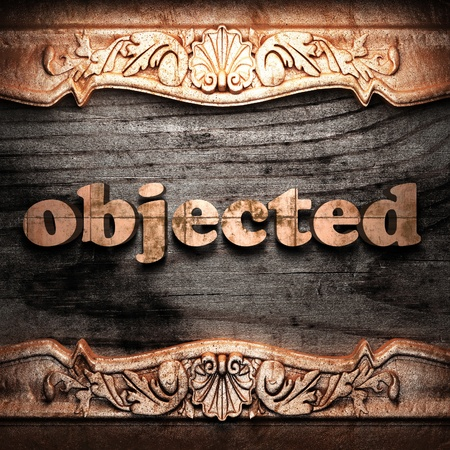 objected: Golden word on wood