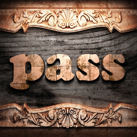 ancient pass: Golden word on wood