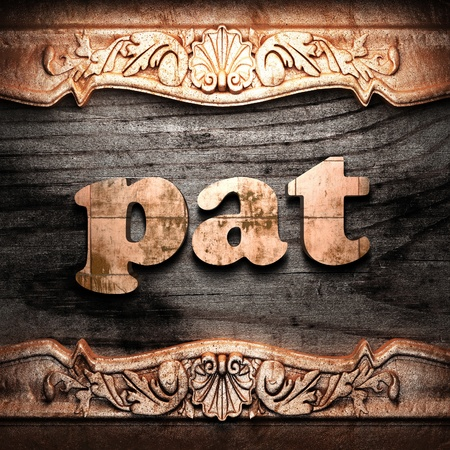 pat: Golden word on wood