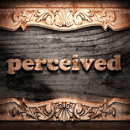 perceived: Golden word on wood
