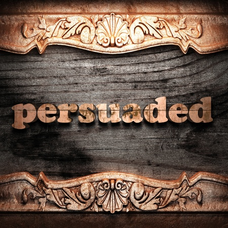 persuaded: Golden word on wood