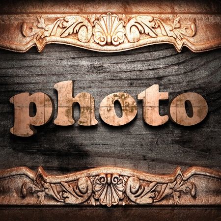 Golden word on wood photo