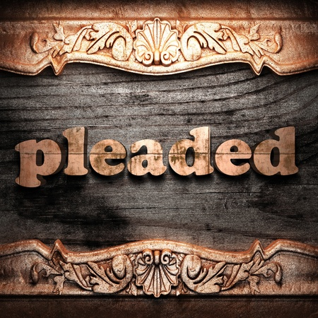 pleaded: Golden word on wood