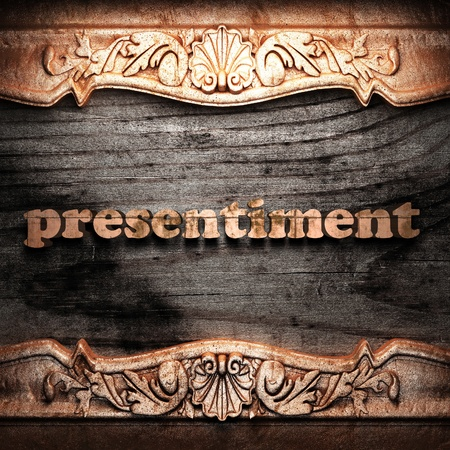 presentiment: Golden word on wood