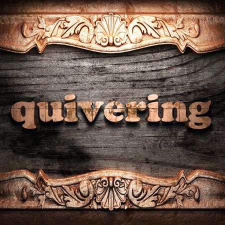 quivering: Golden word on wood