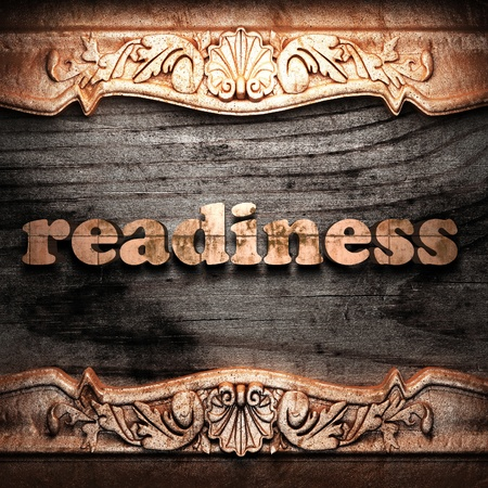 readiness: Golden word on wood