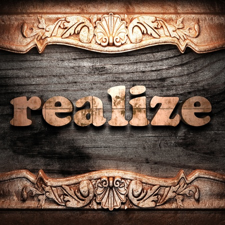 realize: Golden word on wood
