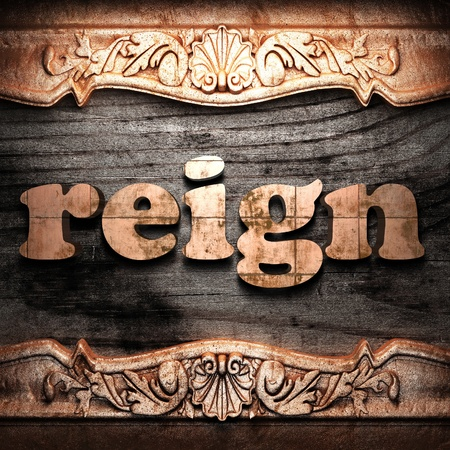 reign: Golden word on wood