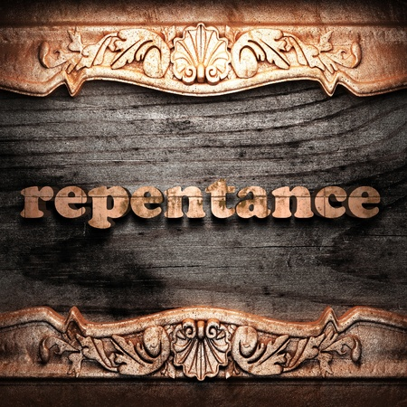 repentance: Golden word on wood