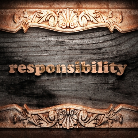 the responsibility: Golden word on wood