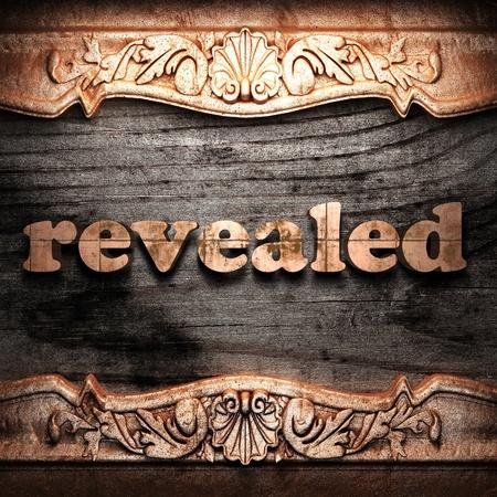 revealed: Golden word on wood