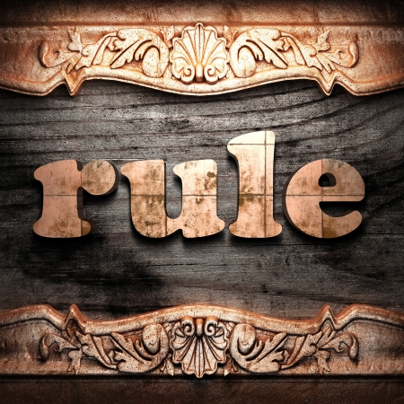 by the rules: Golden word on wood