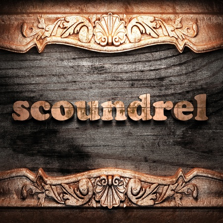 scoundrel: Golden word on wood