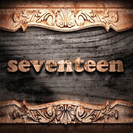 seventeen: Golden word on wood