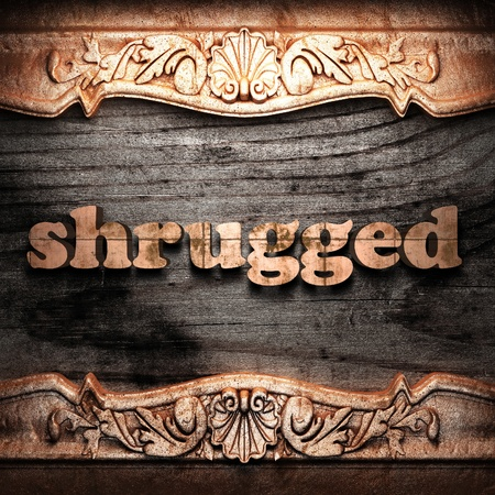 shrugged: Golden word on wood