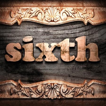 sixth: Golden word on wood