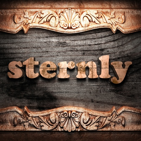 sternly: Golden word on wood