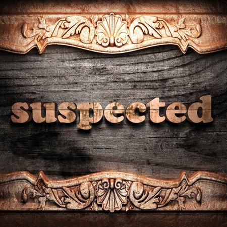 suspected: Golden word on wood