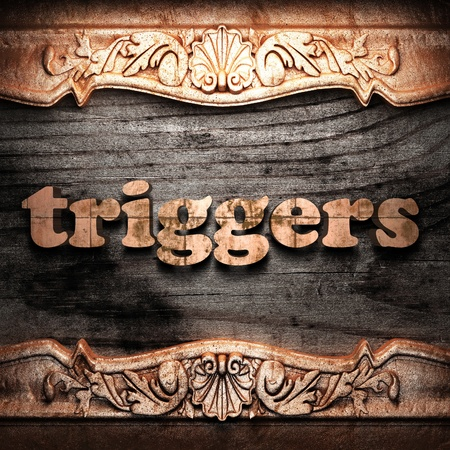 triggers: Golden word on wood