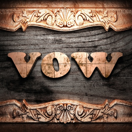 vow: Golden word on wood