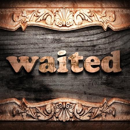 waited: Golden word on wood